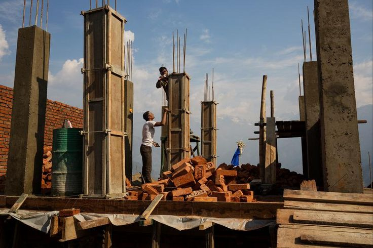Villagers rebuilding houses in Barpak, in Gorkha district, Nepal, at the epicenter of the 2015 earthquakes, which were the worst natural disaster to befall Nepal in more than eight decades,  April 7, 2016.