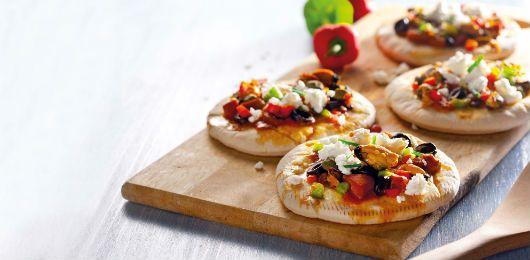 Mini pizzas de mexilhão e lulas