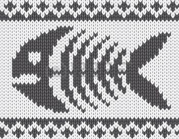 Knitted pattern with fish skeleton. photo