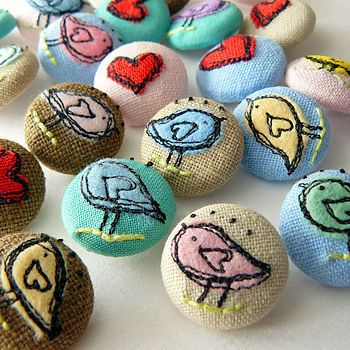 Cute little birdie and heart embroidered fabric covered buttons.