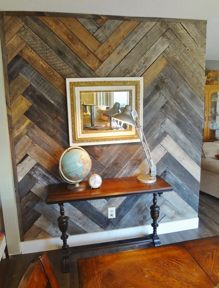 This is my first wall done in my own home. To get this look, I pried apart several pallets and gently sanded the wood with an orbital sander. I stained all of the wood using Minwax's dark w…
