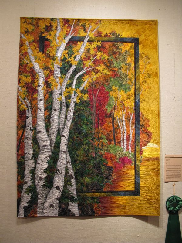 Susan Gilgen, as she walked around with some family members.  This quilt, Autumn Birches