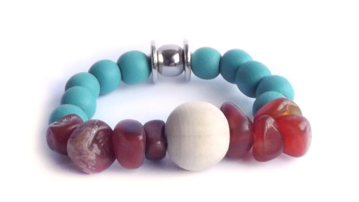 Handpicked carnelian stone with biscay blue. Elastic bracelet.  For price visit website.