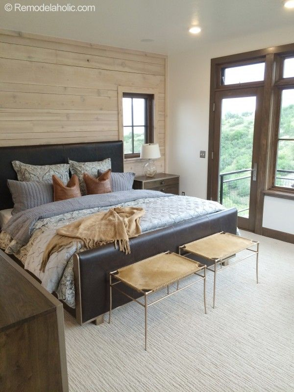 neutral pallette master bedroom. weathered wood, white washed wood, leather, brass, low pile textured carpet. They need some fantastic art above the bed, however.