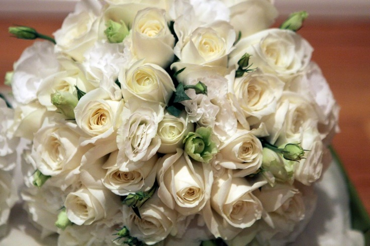 White & ivory roses, with white lissianthus #weddings  www.RedEarthFlowers.com.au