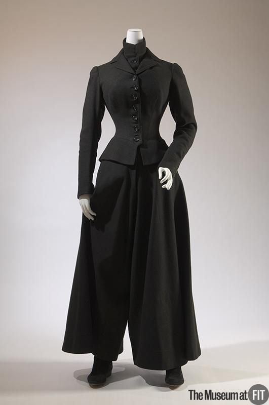 """Medium: Wool Date: 1902 Country: USA Credit: Museum Purchase During the late nineteenth century, women bicyclists wore bloomers or divided skirts, which many found shocking. They were not accepted outside of the sportswear context, and The New York Times warned that divided skirts were """"merely a resting-place on the road to trousers."""" In Paris, bicycling costumes were a fashionable fad, but women risked arrest if caught wearing them while not in the presence of a bicycle."""