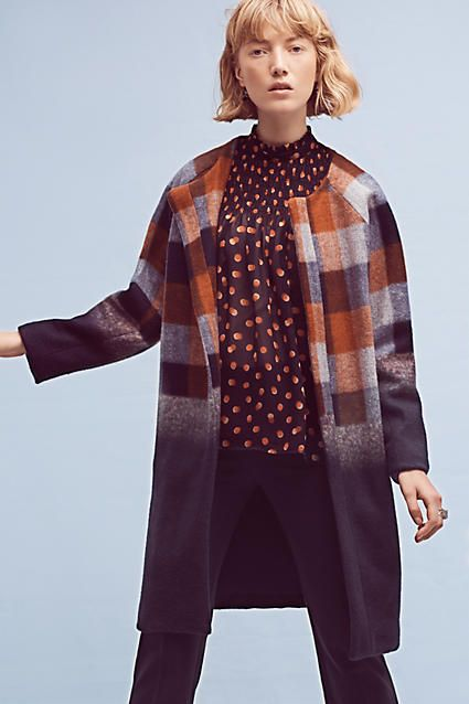 A classic plaid coat gets updated with an ombre fade and an up-to-trend silhouette. Made in the USA by Eva Franco.
