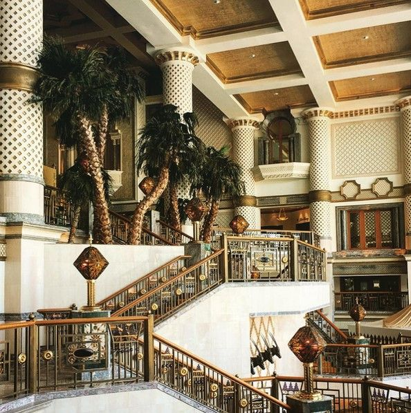Gold bannisters, tiled graphic columns and gilded ceilings awe travelers as they arrive in the Grand lobby at Grand Hyatt Muscat. Photo by @pierricklebourdiec.