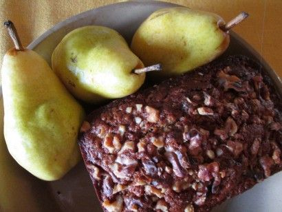 The delightful fruits of fall are as much a part of the changing season as the falling leaves and gray skies. We love apples, of course, but I've been guilty of neglecting the lovely pear. They, too, fill the baskets in the produce section at the grocery store this time of year. Combined with ginger and sourdough, they make an excellent quick bread.