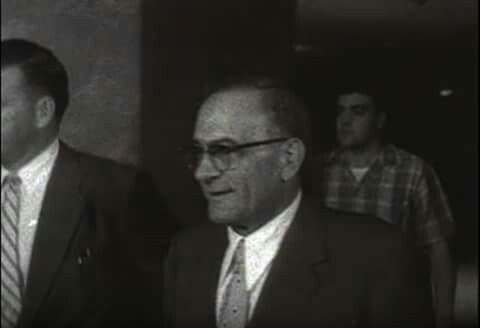 Vito Genovese with Vincent Gigante behind him.