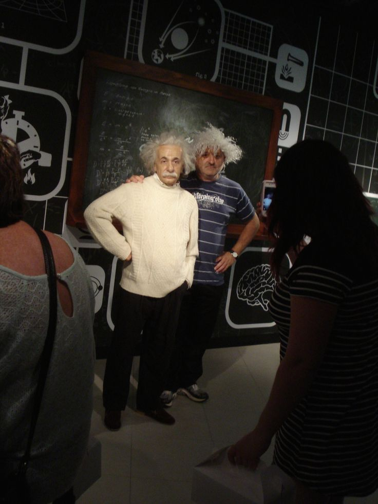 E=MC2 - a random guy posing with a wax figure of Albert Einstein in the Madame Tussaurs gallery in Sydney. APRIL 2014.