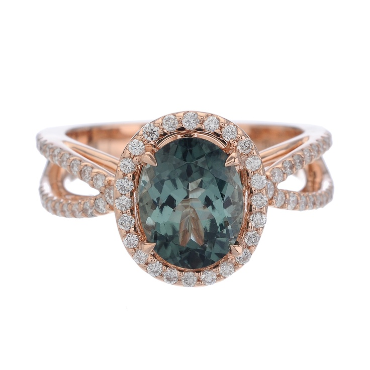Christophe Danhier ring with an oval-shaped tourmaline and brilliant white pave diamonds, in luxurious rose gold.