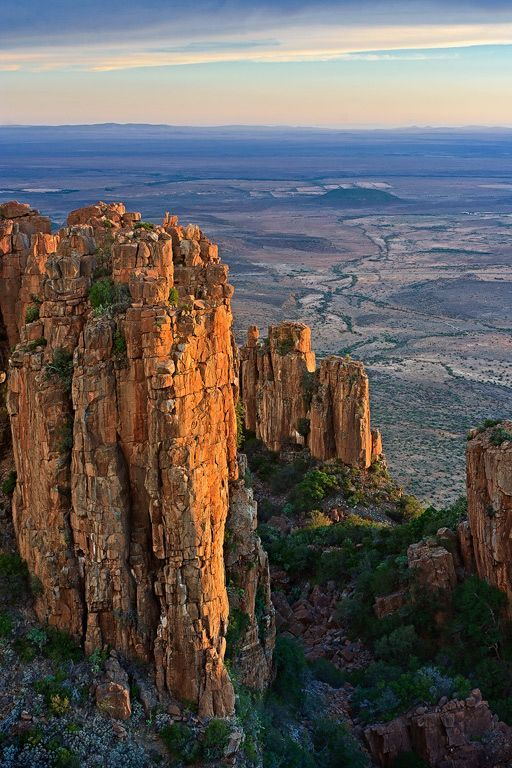 The Valley of Desolation just ouside Graaff- Rienet Eastern Cape South Africa Sunset in January. The Plains of Camdaboo in the distance showing the vast flat lands of the Karoo. Carl Smorenburg