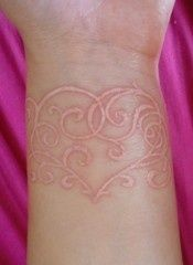 white ink heart swirl tatt