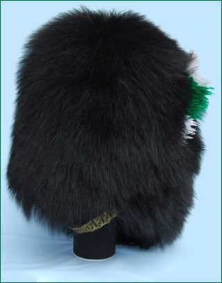 Welsh Guards Other Ranks Bearskin Cap.  All 5 of the British Guard Regiments (Coldstream, Scots, Grenadier, Irish and Welsh) wear the bearskin cap. This began after the Battle of Waterloo, where the Grendadier Guards played a role in turning Napoleon's Imperial Guard - who also worn bearskin caps. This tradition was extended to the other two regiments at the time, and with the formation of the later Irish and Welsh Guards to those units as well.  This example is from the Welsh Guards.