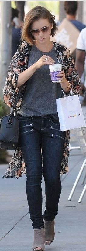 Who made Lily Collins' blue skinny jeans, feather print jacket, and black leather handbag