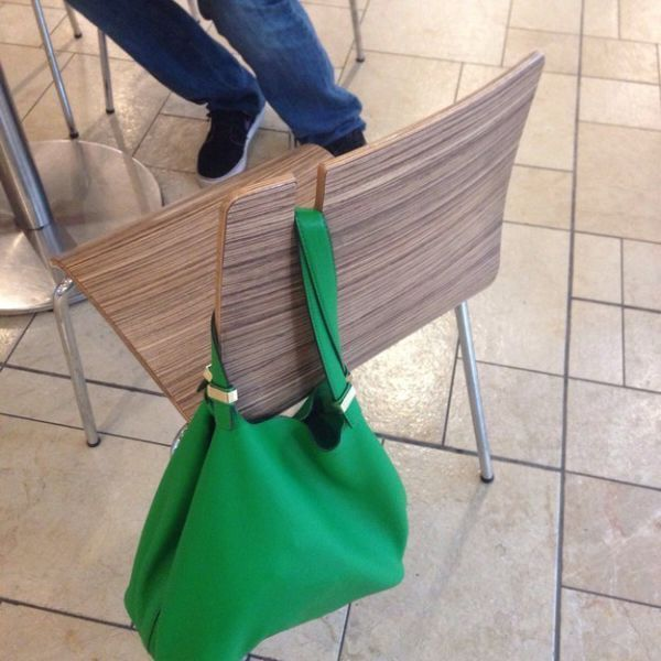 The chair that has a notch cut into it for your bag.