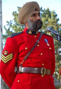 """This primary visual source represents changing internal and external forces which would cause social and political change within our nation. It demonstrates the historical thinking concepts of """"historical significance and cause and effect."""" It depicts the first RCMP officer permitted to wear a turban as part of the uniform because it exercised his religious/cultural freedoms as outlined in the Charter. It also exemplifies how immigration has helped Canada develop as a pluralistic society."""