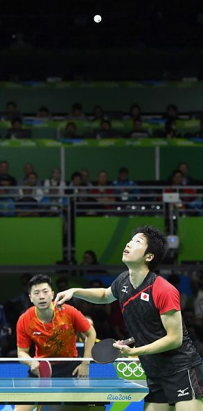 #RIO2016 Japan's Jun Mizutani tosses the ball for a serve in his singles semifinal match against Ma Long of China at the Rio Olympics on Aug 11 2016 Ma won...