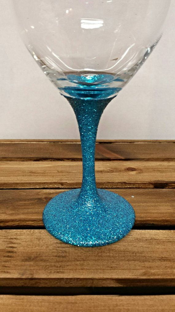 Blue Glitter Wine Glass. Bridesmaids Gift. Wedding Favor. Check out this item in my Etsy shop https://www.etsy.com/listing/271454111/glitter-stemmed-wine-glass-blue-glitter