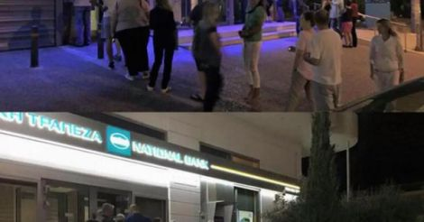 Greeks Line Up At ATMs; Alpha Bank Limits Online Banking