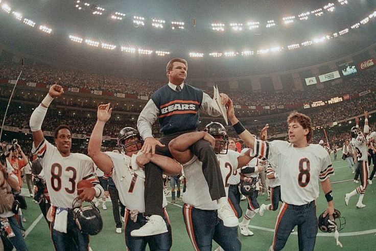 Chicago Bears head coach Mike Ditka is carried off the field by Steve McMichael, left, and William Perry