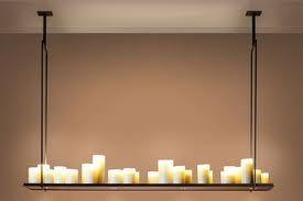 """MOOIE LAMP!!!!!!!!!!!!!!! """"Altar"""" design Kevin Reilly: stalen frame met 29, 25, 21, 17 of 11 kaarsen waarin lichtpunten bevestigd zijn."""