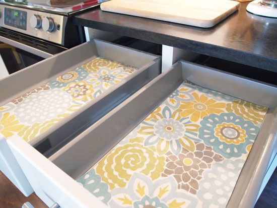 Lovely drawers: use pretty fabric topped with peel-and-stick clear Contact paper. No more ugly vinyl!