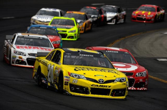 2015 NASCAR Sprint Cup Schedule: Matt Kenseth leads Kyle Larson during the NASCAR Sprint Cup Series Camping World RV Sales 301 at New Hampshire Motor Speedway in 2014.