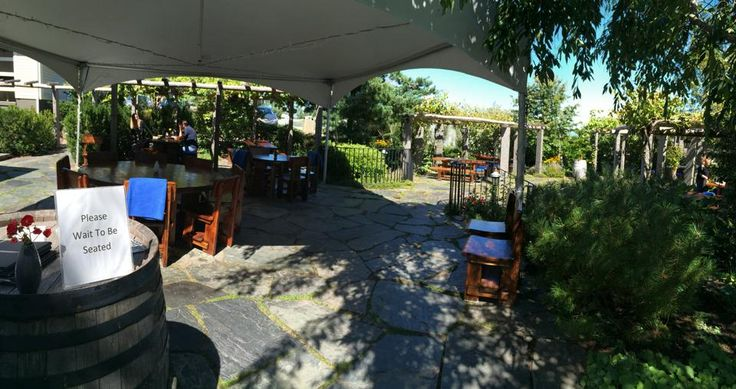 Le Caveau Restaurant, Grand Pre, Nova Scotia | Come and dine on our outdoor patio! It's opened as long as the weather permits!