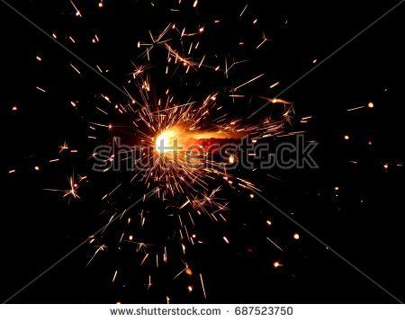 Sparklers with sparks on a black background