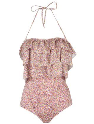 Really freaking adorable!! I love the ruffles on this swimsuit especially for us smaller busted women <3