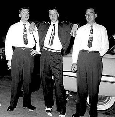 Scotty Moore, Elvis Presley, and Bill Black in Memphis on September 9, 1954. This photo was taken barely two months after the release of their first record.
