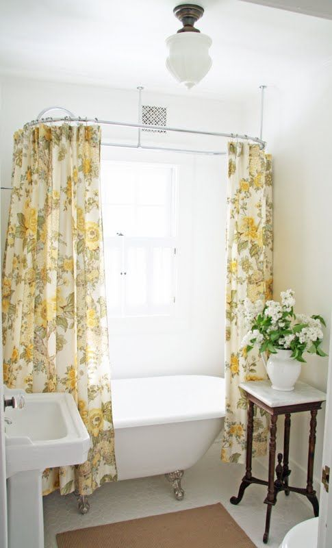 for our bathroom redo? would add classic black & white penny tile, nix the rug and hang drapes over window