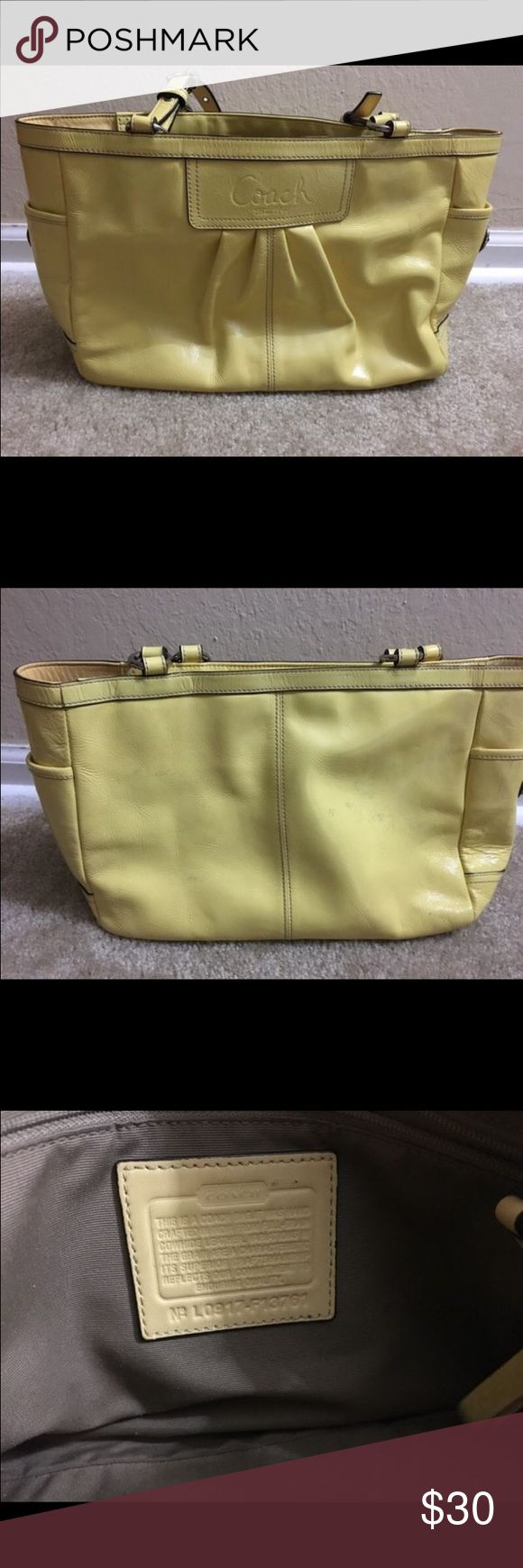 Yellow coach purse Yellow coach purse. In good condition a few dirty marks but can be cleaned. Coach Bags Shoulder Bags