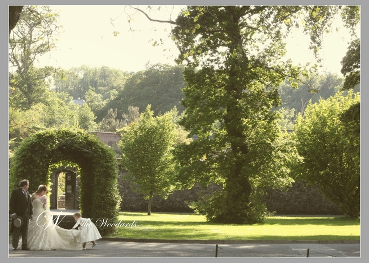 Summer Wedding at Dromoland Castle.    Bride being assisted by the flower girl.