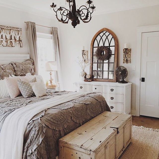 Love the look of an old rustic trunk at the end of the bed
