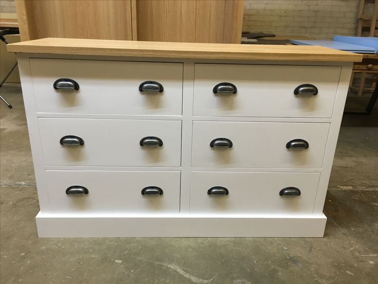 Large Chest of drawers with merchant iron cup handles and a solid oak top. Made to order by Cobwebs Furniture Company.
