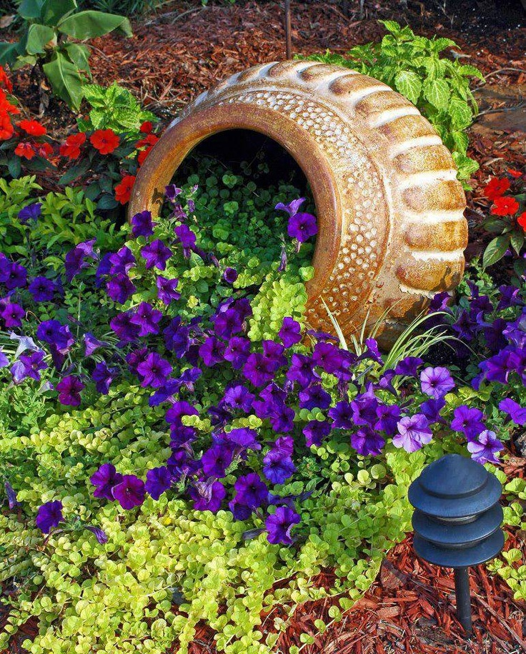 Add an overturned plant pot to any flower bed to add a for Easy plants to grow in pots outside