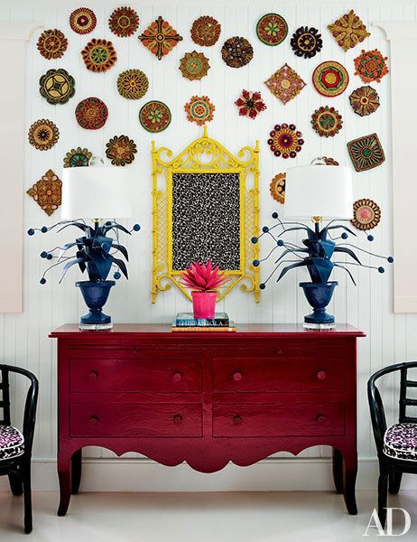 Vintage trivets join a wicker mirror in one of the children's rooms; the lamps are by Stray Dog Designs.