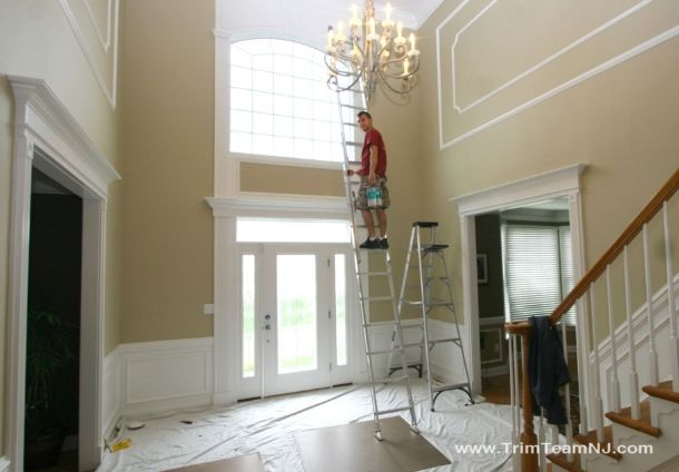 foyer wall trim work shadow boxes wainscot   and door ...