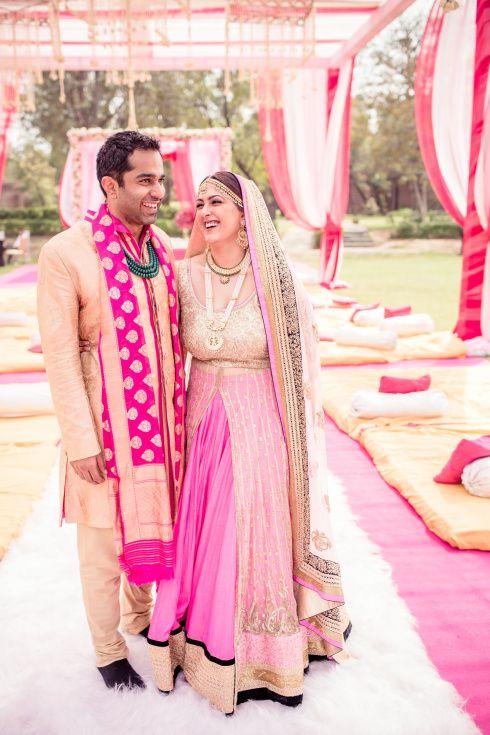 Who else thinks her bubblegum pink lehenga is PERFECT for a day wedding?  #sikhwedding #beautifulindianbrides  Image by Photo Tantra