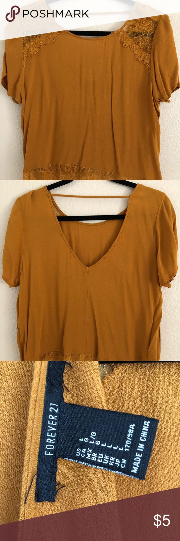 Crop top Blouse short sleeves Camel color crop top v neck opening shape from back very cool,stretchy material lace there is two wash off stains Forever 21 Tops Crop Tops