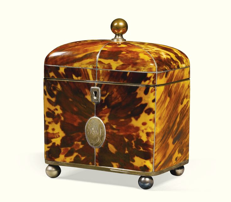 A William IV tortoiseshell domed tea caddy,  with brass ball feet and finial,  16cm. high, 13cm. wide, 8.5cm. deep; 6¼in., 5in., 3½in.