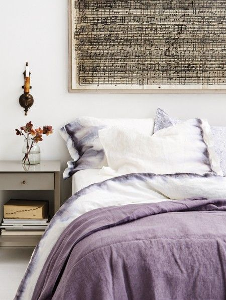 When black Sharpie permanent marker is sprayed with rubbing alcohol, it takes on a lilac hue that blurs gradually into the natural linen weave of sheets. The finished effect is organic and tranquil — and yes, they're washable!
