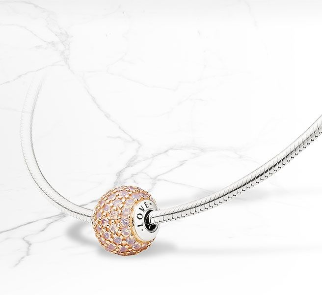 PANDORA ESSENCE COLLECTION Love charm in 14k rose gold with sterling silver core and 75 pavé-set opalescent pink crystals. A true beauty! #Spring2015
