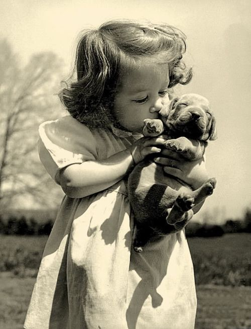 It doesn't get much better than little girls and their puppies.