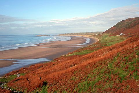 Surfing at Rhossili Beach in Wales