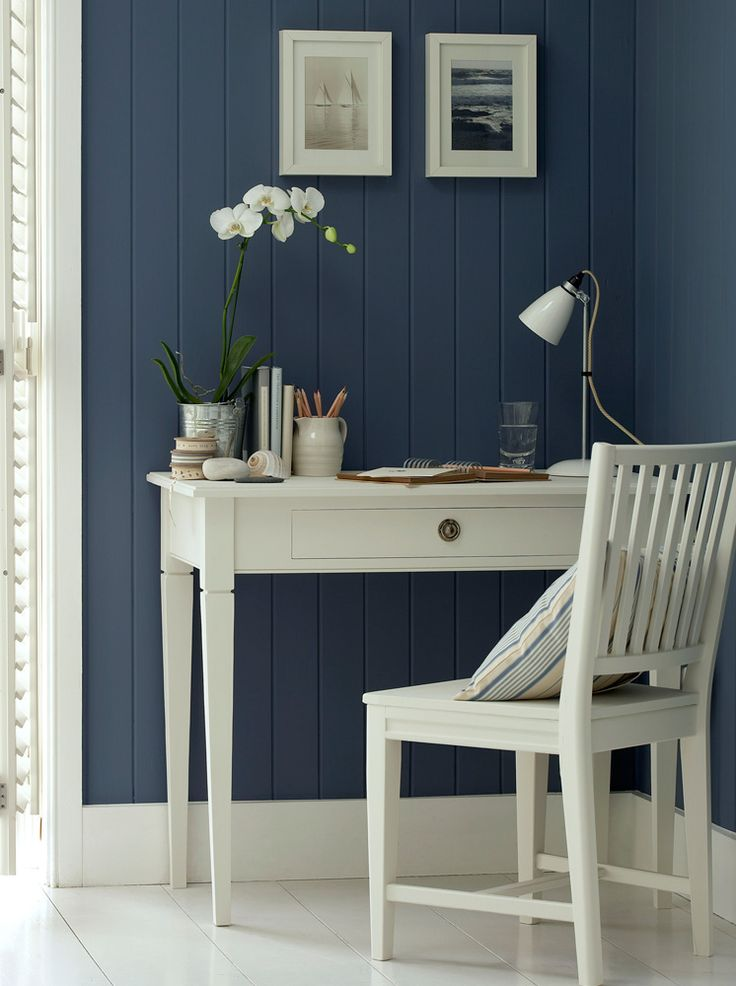the dark wall and white furniture works so well, not to mention, I am in love with that color