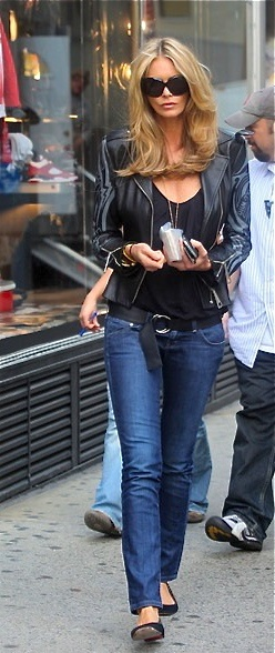 Elle Macpherson - black top and leather jacket with jeans